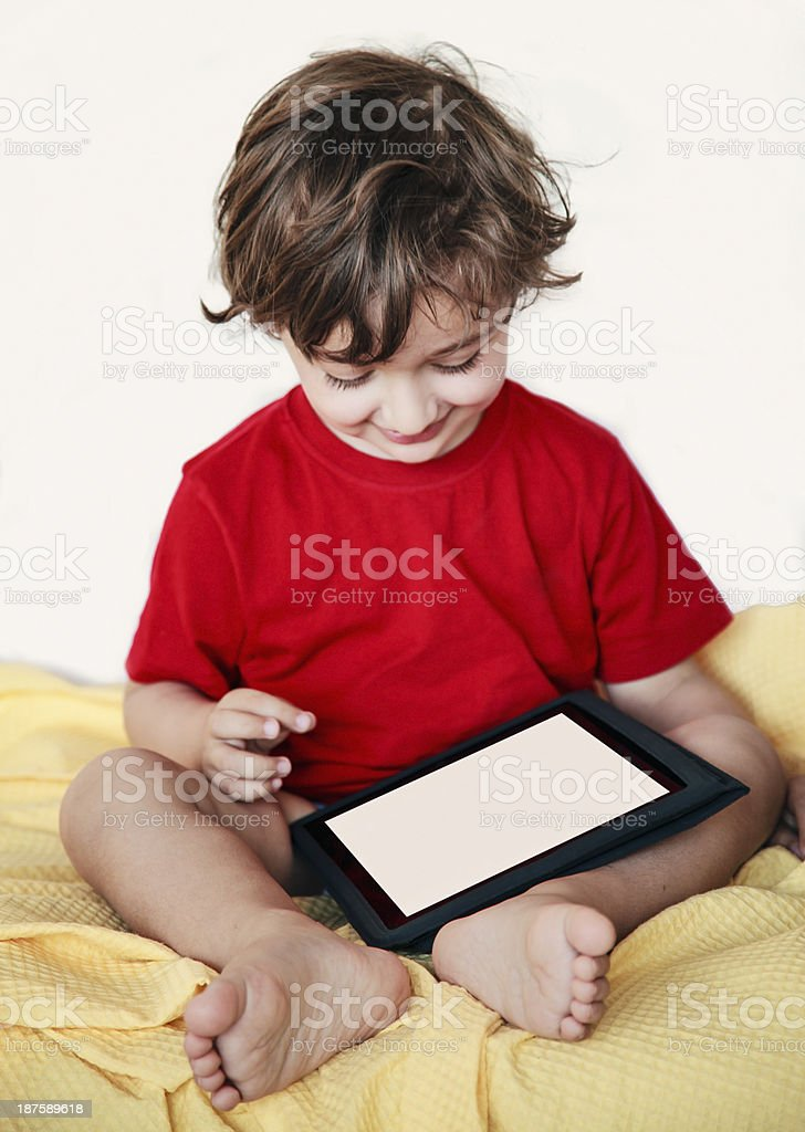 Baby boy using tablet PC royalty-free stock photo