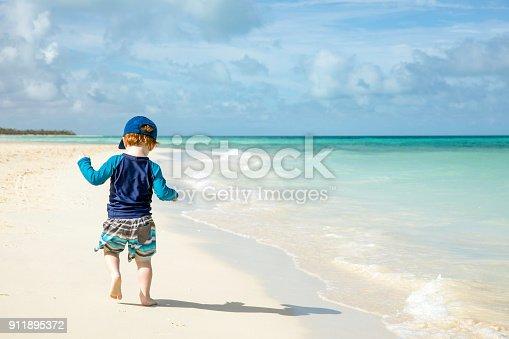 istock Baby Boy Walking on Tropical Beach, Cayo Coco, Cuba 911895372