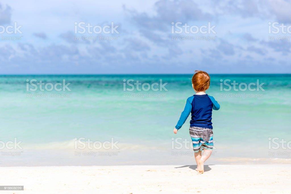 Baby Boy Walking on Tropical Beach, Cayo Coco, Cuba stock photo