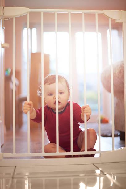 Baby boy wants his freedom stock photo