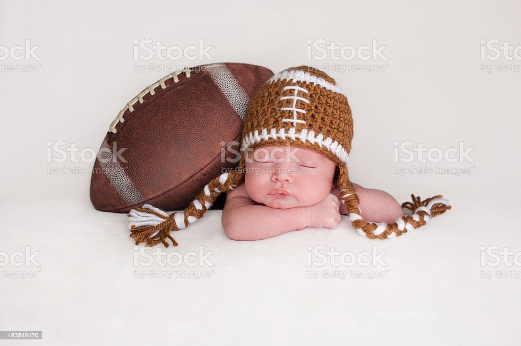 Baby Boy Wearing a Crocheted Football Hat stock photo