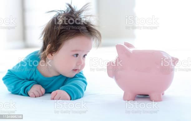 Baby boy with a piggy bank picture id1134998256?b=1&k=6&m=1134998256&s=612x612&h=w xm0ih3l8w9yywj8ui4o4jxp0f4aiyysjymyu6nwcc=
