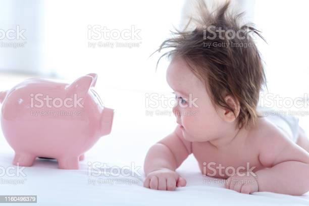 Baby boy with a piggy bank picture id1160496379?b=1&k=6&m=1160496379&s=612x612&h= geyc bfnmolbetmsfclnpwpufwjbwlg sknda7sgly=