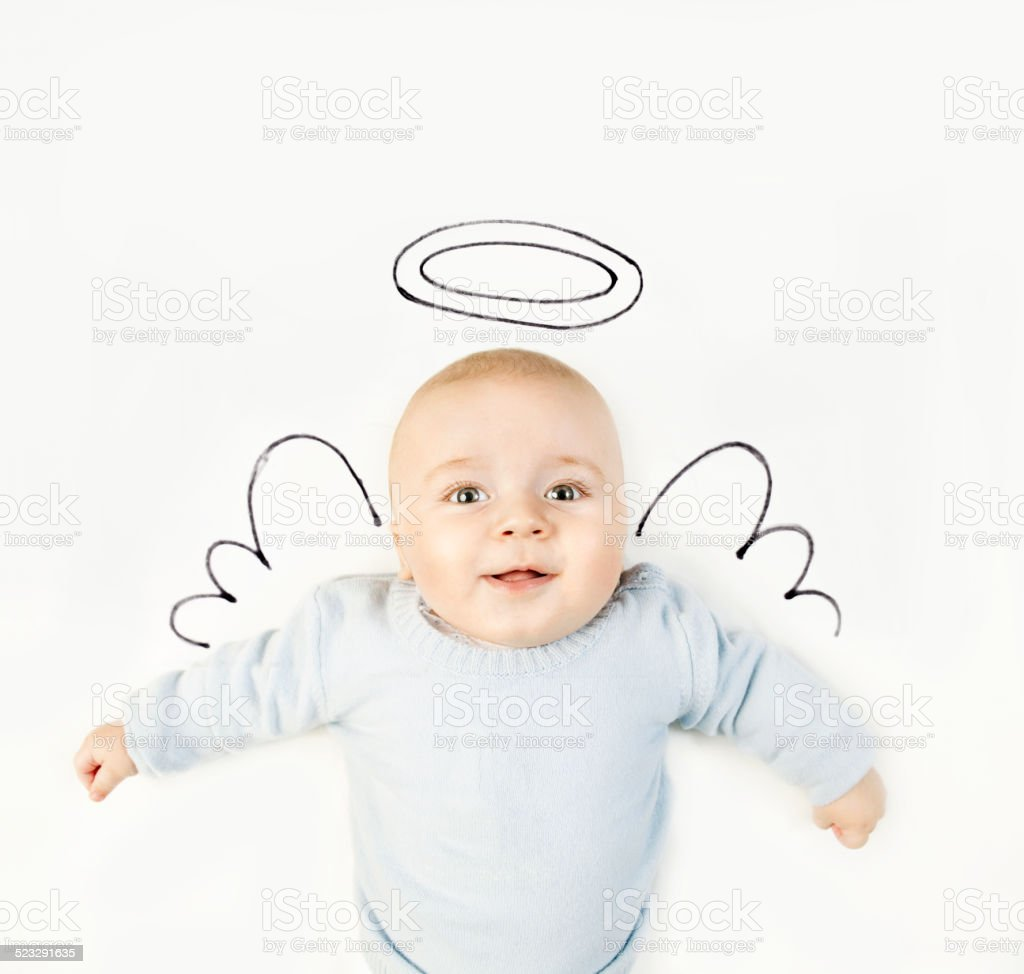 Baby boy with angel wings stock photo