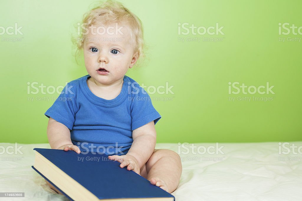 Baby boy with book royalty-free stock photo