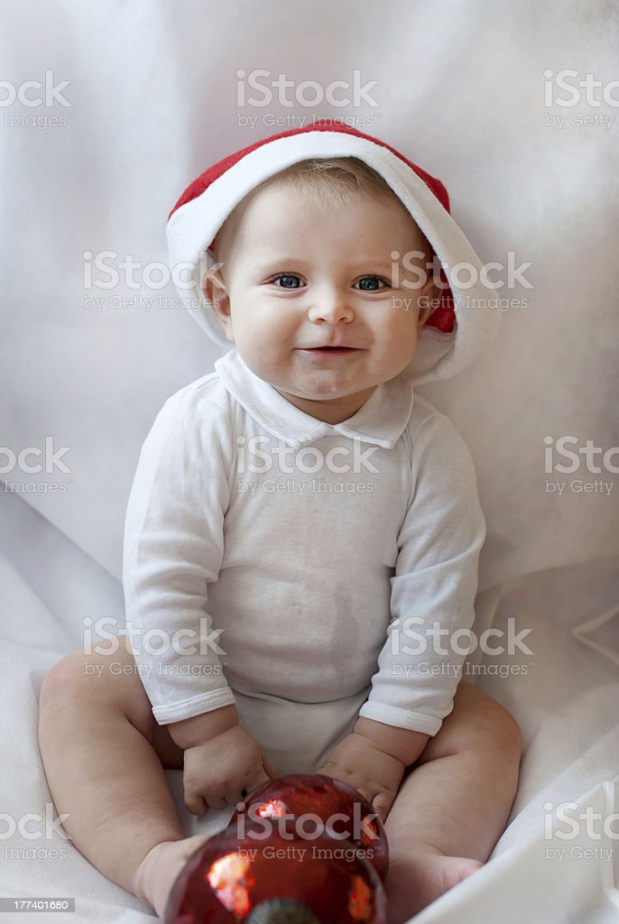 3b41256539b Baby boy with Christmas cap and ball on white background royalty-free stock  photo