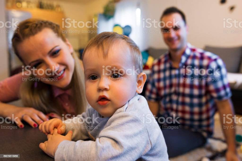 Baby boy with his parents royalty-free stock photo