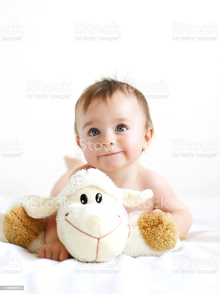 Baby boy with lamb stuffed toy royalty-free stock photo