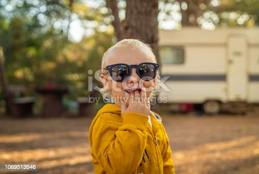 istock Baby boy with sunglasses smiling. 1069513546