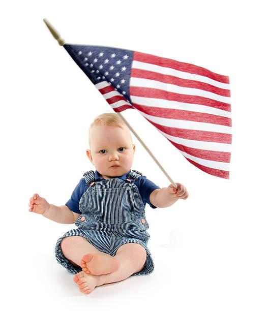 Baby boy with United States flag stock photo