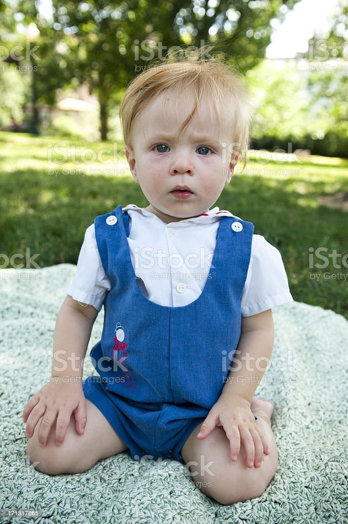 Baby boy with upset expression royalty-free stock photo