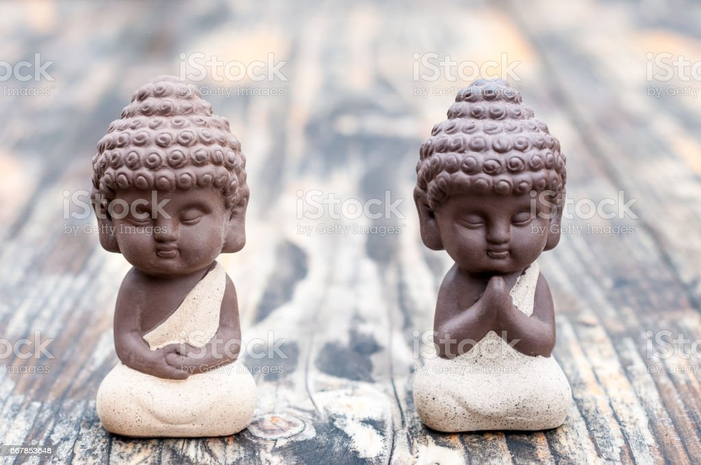 Baby Budda Statues, Teacher or master and apprentice. Two little monks. Meditation and zen, relaxation concept stock photo