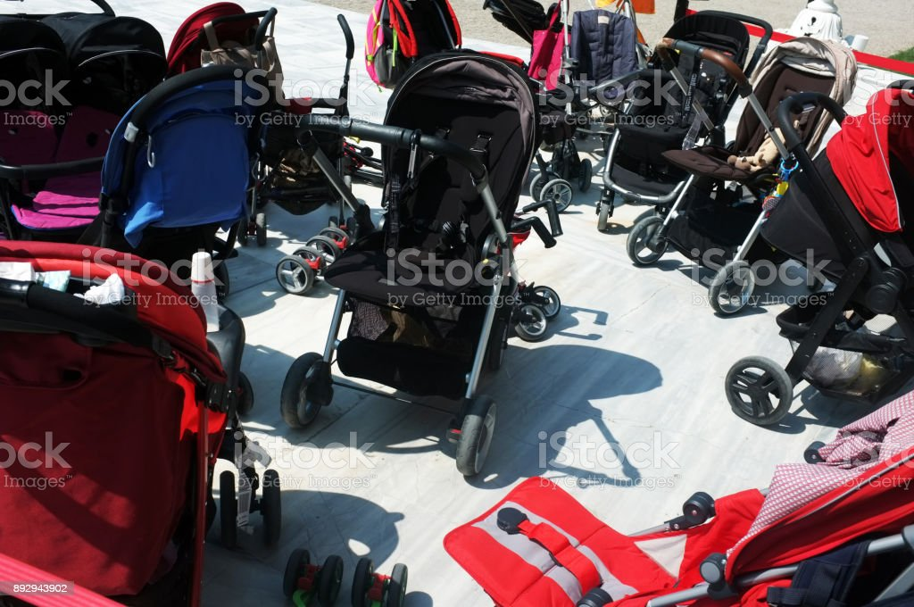 Baby buggies parked outside stock photo