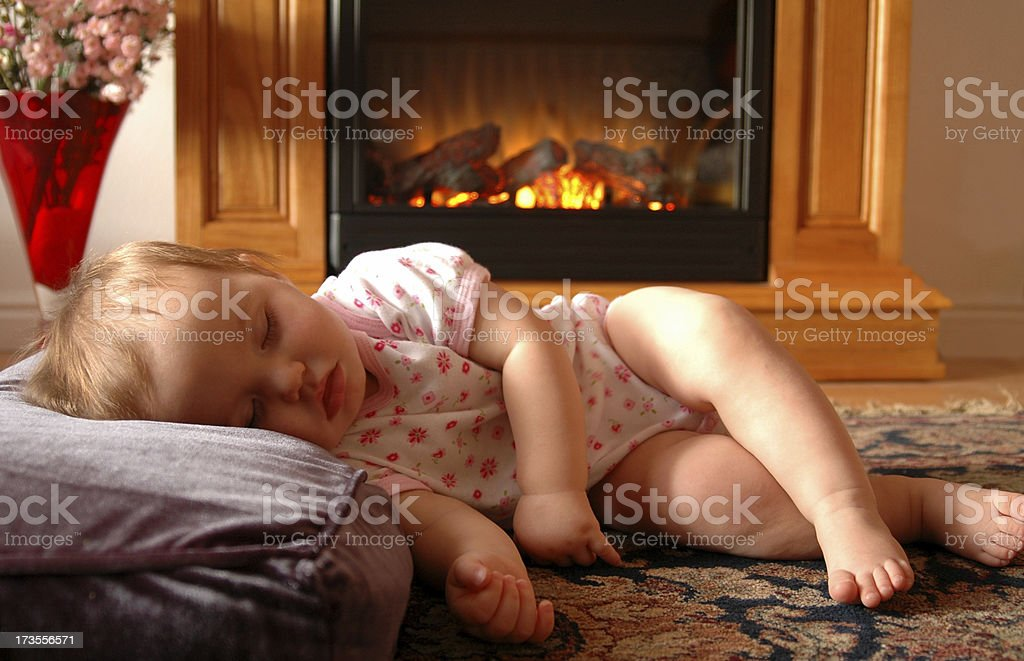 Baby by Fire royalty-free stock photo