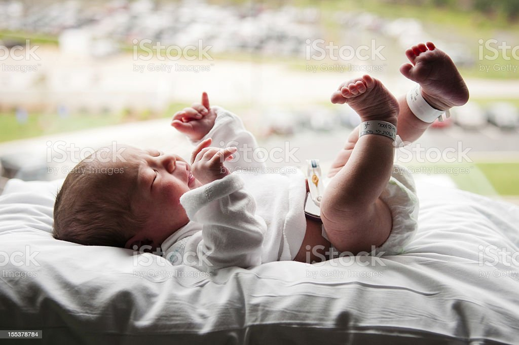 Baby by Window stock photo