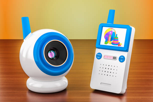Baby cam and audio baby monitor on the wooden table. 3D rendering stock photo