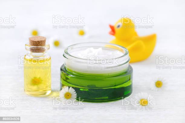 Baby care products natural cream massage oil and fresh chamomile picture id893534526?b=1&k=6&m=893534526&s=612x612&h=uucdg43jnvh4toq9xogsmvefgichn9noqaeavs60uqy=