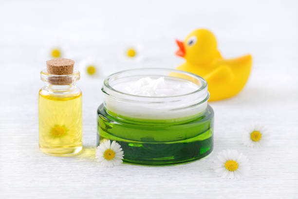 Baby care products natural cream massage oil and fresh chamomile picture id893534526?b=1&k=6&m=893534526&s=612x612&w=0&h= bdjr6zr3toyzjogxd9gfkoyapzkqbf8pxdkb lti9g=