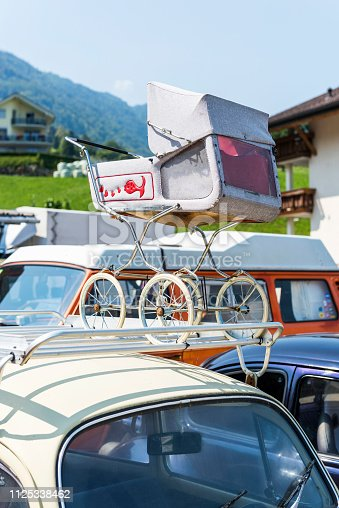 Lauerz (Canton of Schwyz), Switzerland - August 21, 2018: Baby carriage concept on vintage volkswagen car. Old Wolkswagen cars renewal service (Extreme Cars) in Lauerz, Canton of Schwyz, Switzerland. Here, rash cars and minibuses are renewed and sold as second hand.