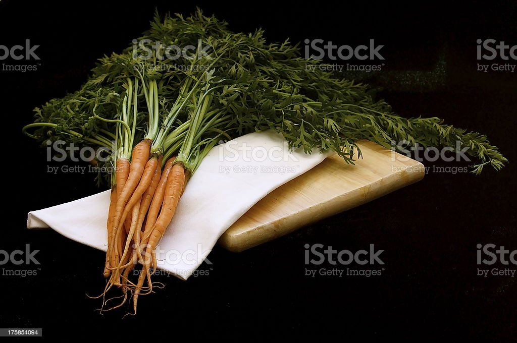 Baby carrots on chopping board royalty-free stock photo