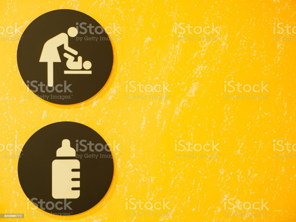 Baby Changing Room Sign and Symbol with yellow background. stock photo