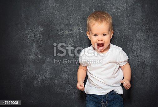 istock baby child and empty Blackboard 471990081