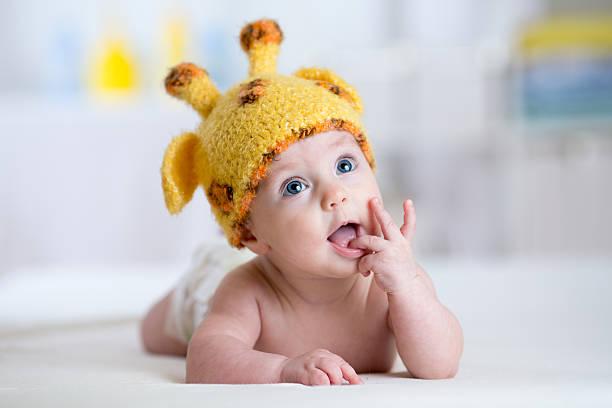baby child in costume of giraffe stock photo