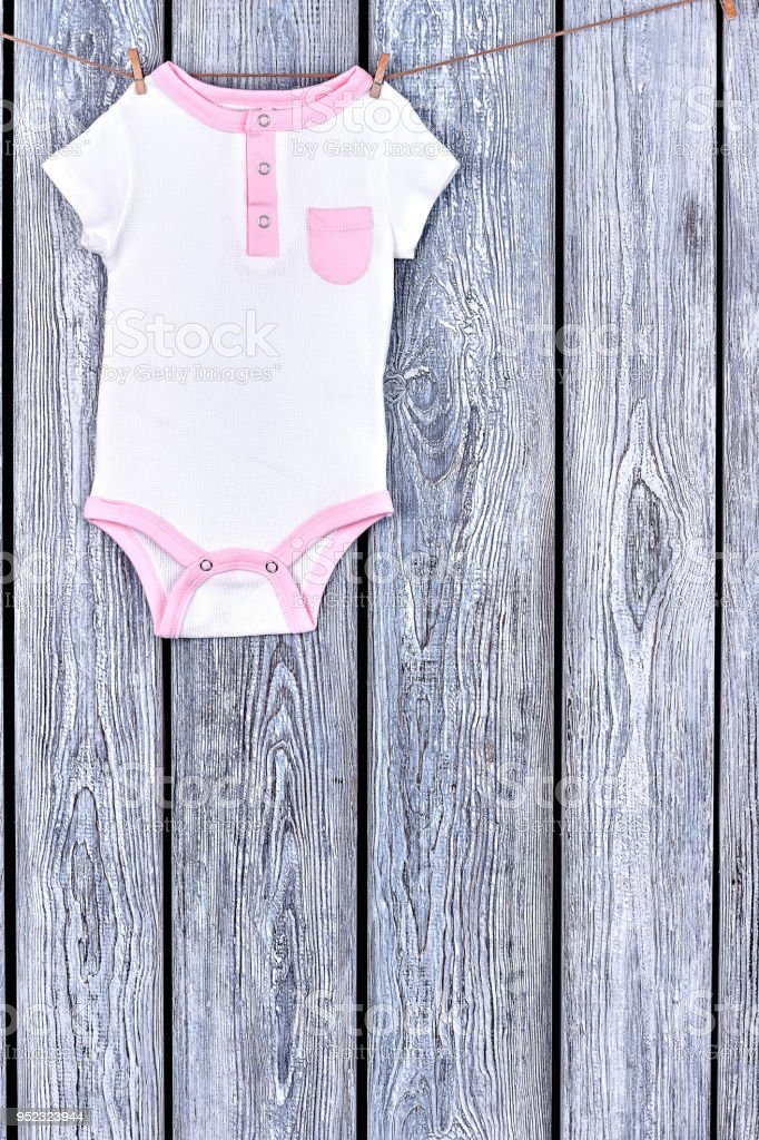 9b276e1725e9 Baby Clean Bodysuit Hanging On Rope Stock Photo   More Pictures of ...