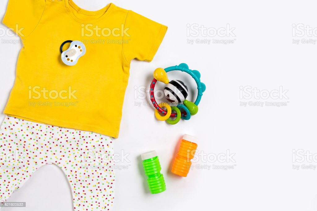 bb1cfb7bf2d5 Baby Clothes And Accessories On White Background Top View Stock ...