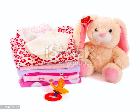 istock baby clothes and flower 179072457