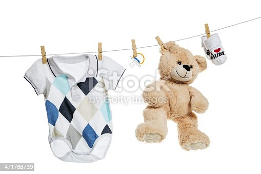 istock Baby clothes and  teddy bear hanging on the clothesline 471788739