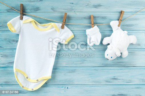 istock Baby clothes and white bear toy on a clothesline 616134186