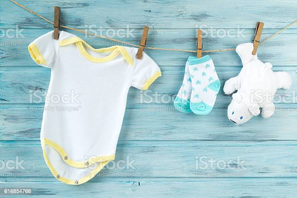 Baby clothes and white bear toy on a clothesline picture id616854766?b=1&k=6&m=616854766&s=612x612&h=szlzndz6izyddmuicdvh jw53tehx0y4nzyl5v1mdl4=