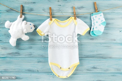 istock Baby clothes and white bear toy on a clothesline 622971780