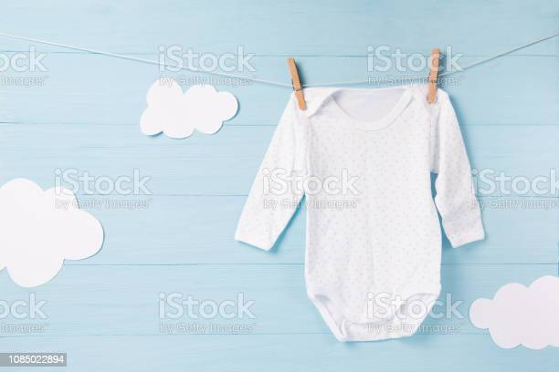 Baby clothes and white clouds on a clothesline blue background picture id1085022894?b=1&k=6&m=1085022894&s=612x612&h=ud9ole3i38tx4s0zbacqpoxc8mh4aireqs5xejaehay=