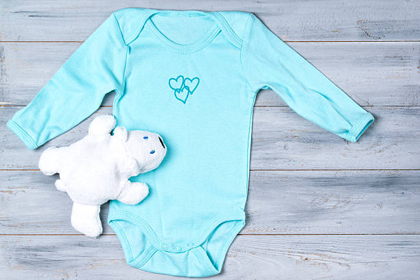 Baby clothes and white toy bear on a wooden background picture id622923882?b=1&k=6&m=622923882&s=612x612&w=0&h=kg5p3gtlapstelnz v0o6s4y3 ib5rdr3fggx2x 9p4=
