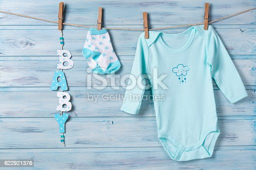 istock Baby clothes and word baby on a clothesline 622921376