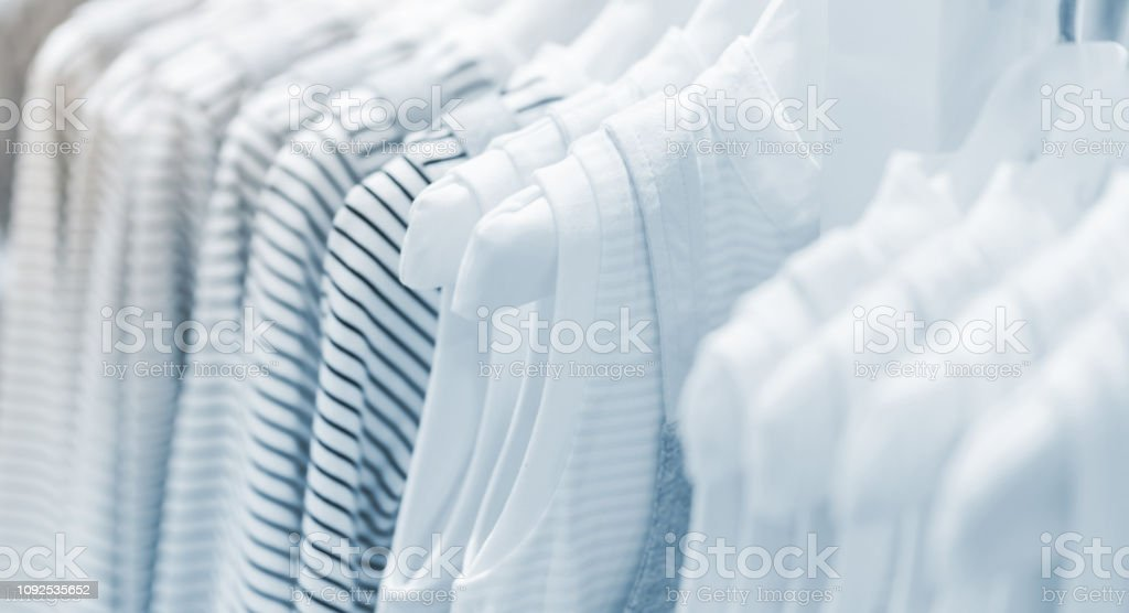 Baby clothes collection hanging in show room royalty-free stock photo