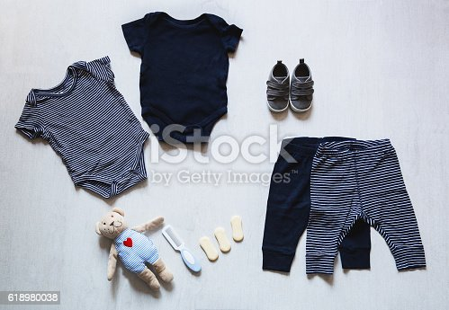 istock Baby clothes, concept of child fashion. 618980038