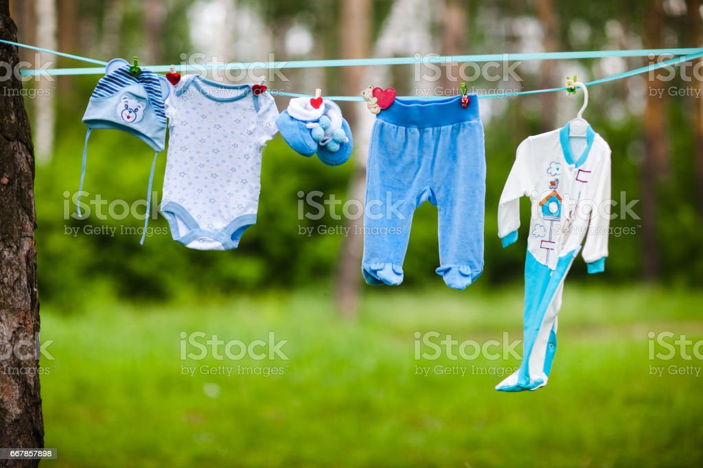baby clothes hanging on a rope outdoors stock photo more pictures