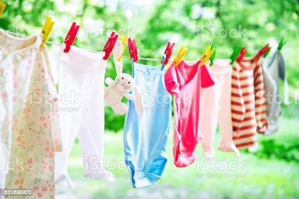 Baby clothes hanging on the clothesline outdoor picture id831896920?b=1&k=6&m=831896920&s=612x612&h=vk26vl2cjbiqjwtjz8zrkrgqd0djmyjvtd kx 5dpyi=