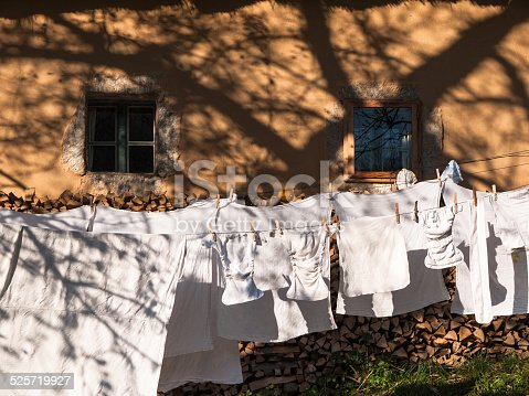 istock Baby clothes hanging on the clothesline 525719927