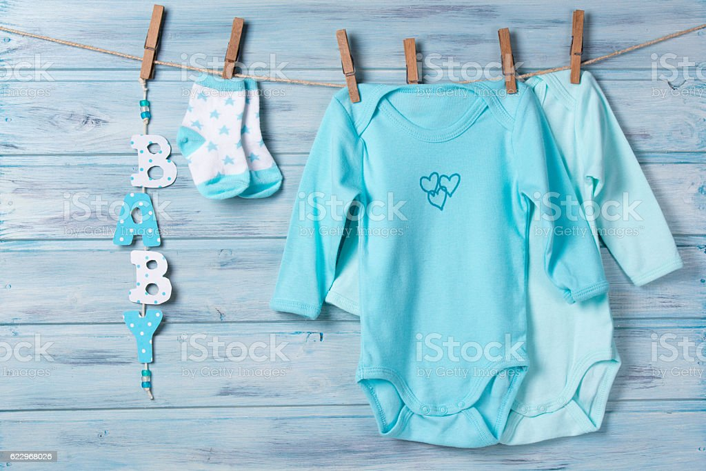 669b6190d Baby clothes, little socks and word baby on a clothesline - Stock image .