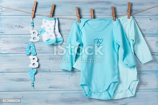 istock Baby clothes, little socks and word baby on a clothesline 622968026