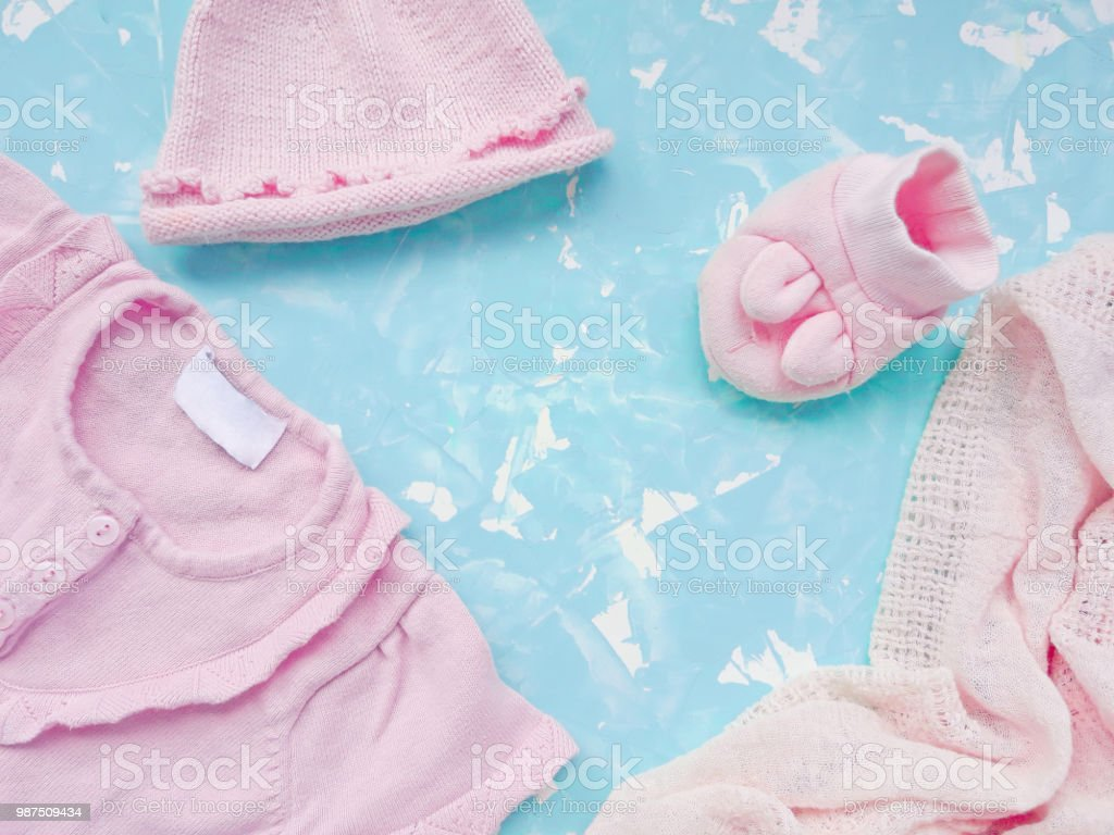 Baby Clothes Of Pink Color On A Light Blue Marble Background Stock Photo Download Image Now Istock