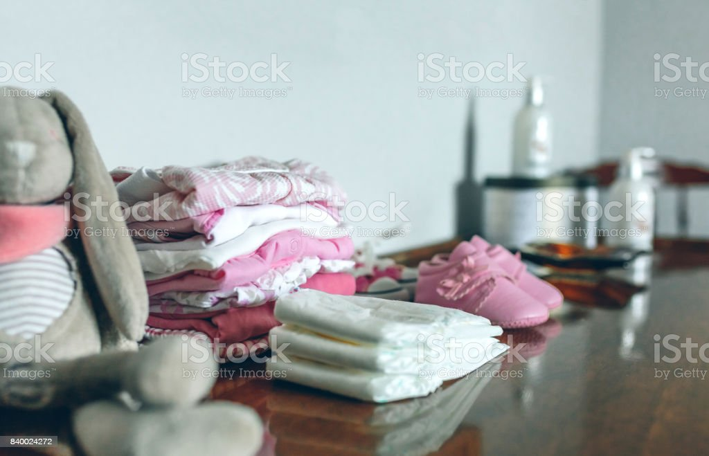 Baby clothes ready for her arrival stock photo