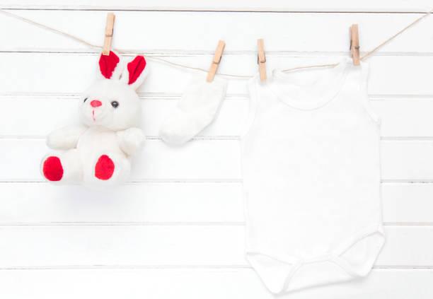 Baby clothes socks toy on a clothesline picture id846889298?b=1&k=6&m=846889298&s=612x612&w=0&h=qdsqhyv6i4vstl5qdxwbk1ilp0ieamanupqqj4ul6uq=