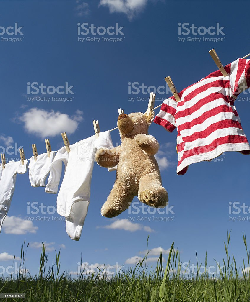 Baby clothing on a clothesline stock photo