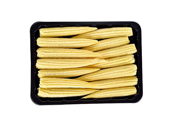 baby corn in back tray isolated on white background stock photo