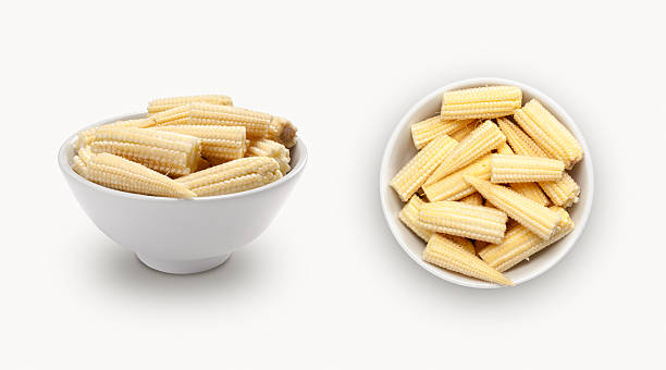 baby corn in small white bowl stock photo